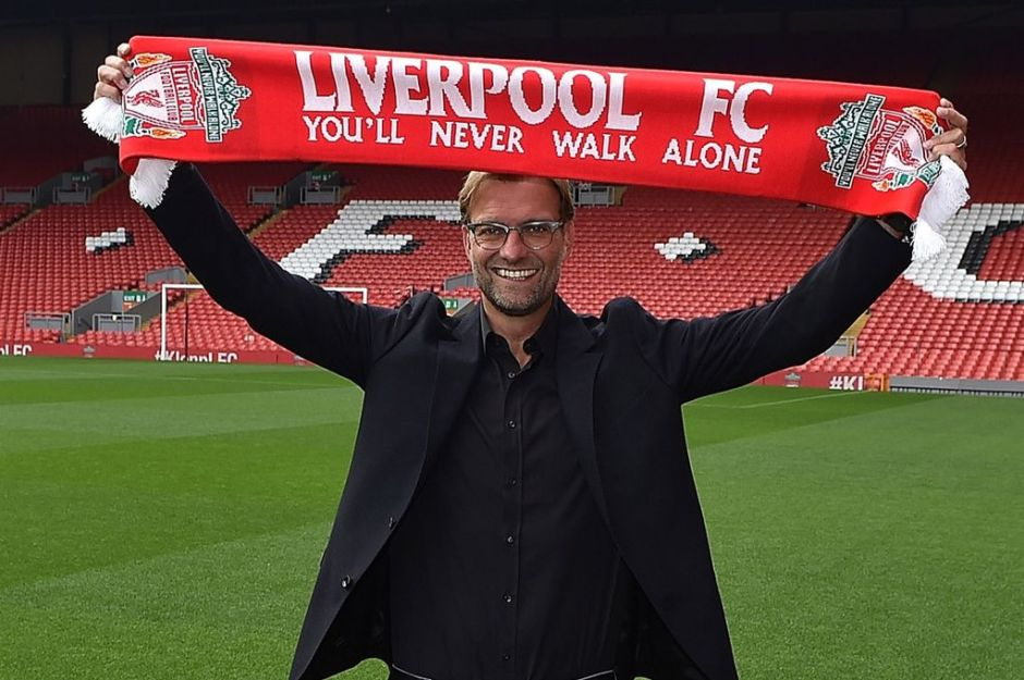Jurgen-Klopp-new-manager-of-Liverpool-at-Anfield-holds-up-a-scarf